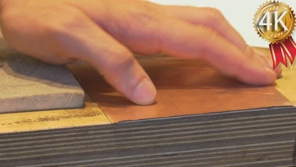 Thumbnail for Man's Hands Take The Square Piece of Copper Plate