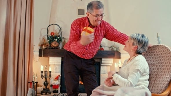 Thumbnail for Mature Man Giving a Present To Wife