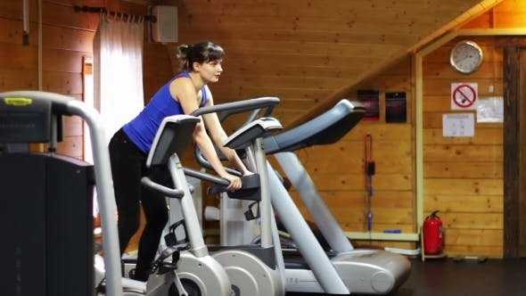 Thumbnail for Girl On The Fitness Trainer At The Gym.