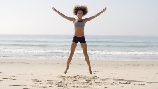 Thumbnail for Fit Woman Jumping On The Beach