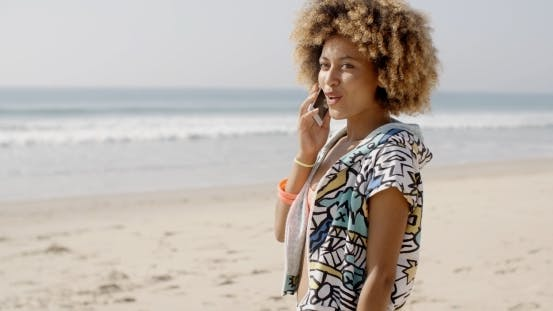 Thumbnail for Girl Talking At Mobile Phone On The Beach