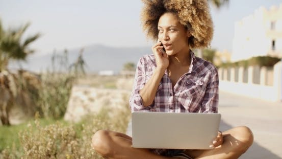 Thumbnail for Young African Woman Working On Laptop In Nature.