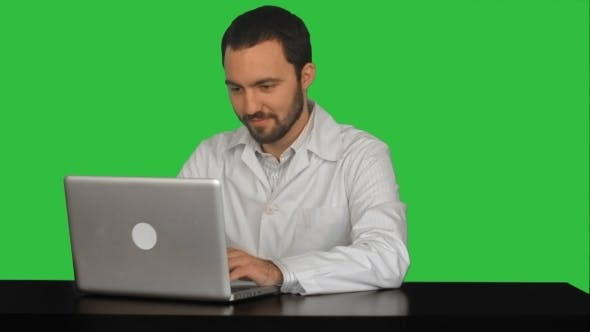 Thumbnail for Concentrated Male Doctor Using Laptop At Medical