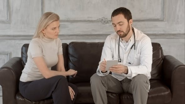 Thumbnail for Male Doctor Writing Prescription For His Patient