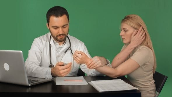 Thumbnail for Doctor With Patient Measuring Pulse In a Hospital