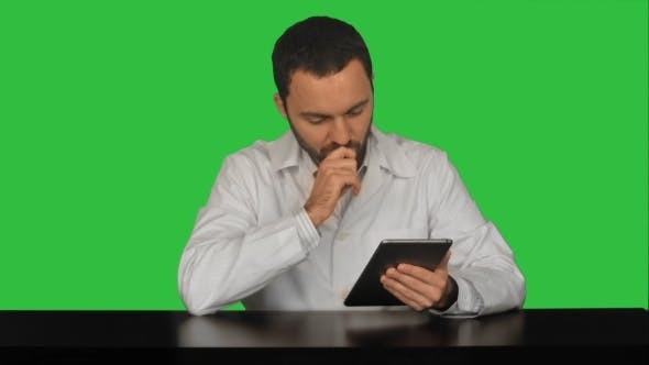 Thumbnail for Male Doctor With Digital Tablet At Medical Office