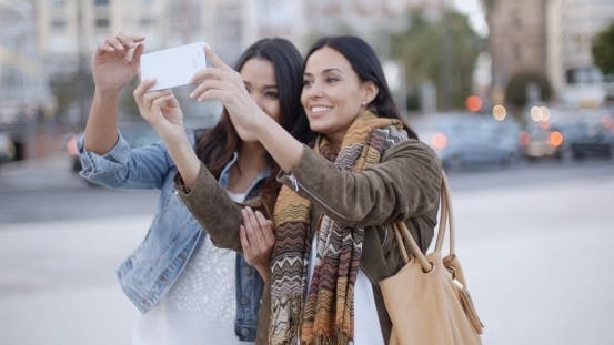 Thumbnail for Two Gorgeous Women Posing For a Selfie
