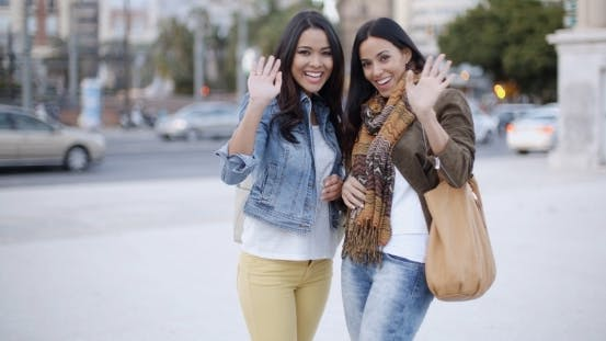 Thumbnail for Happy Young Women Waving At The Camera