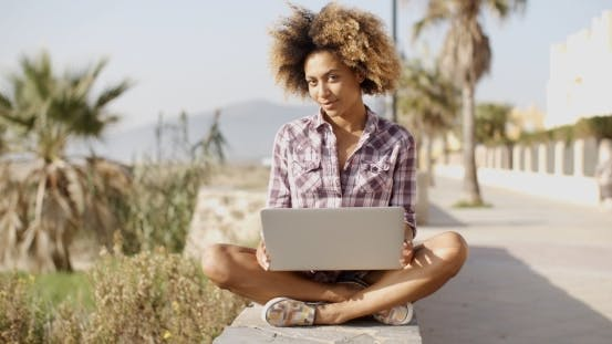 Thumbnail for Girl Browsing A Laptop In A Bench
