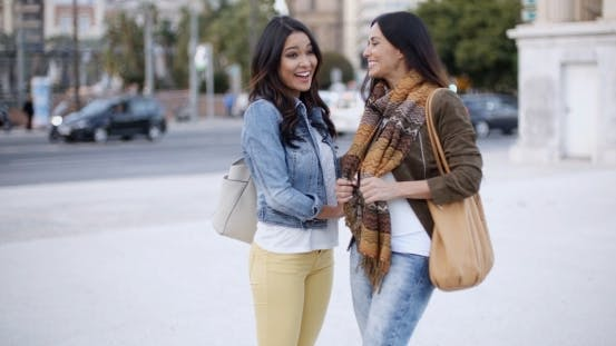 Thumbnail for Two Stylish Women Chatting Outdoors In a Town