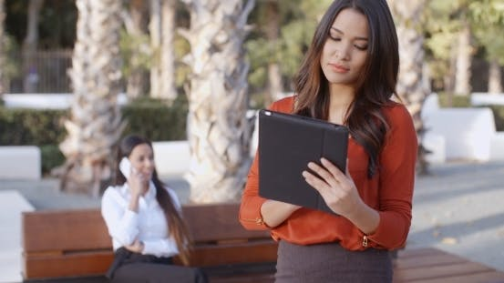 Thumbnail for Young Businesswoman Using a Tablet Outdoors