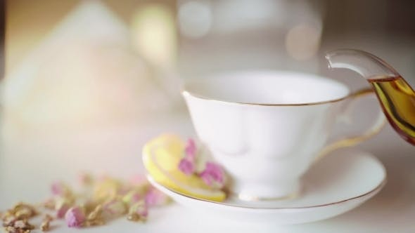 Thumbnail for Pour Tea In a Beautiful White Cup With Lemon