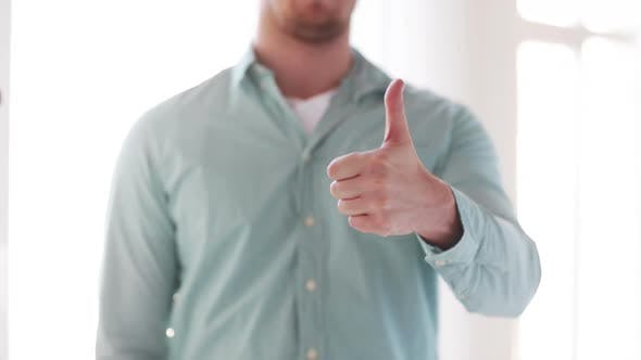 Thumbnail for Closeup Of Man Showing Thumbs Up