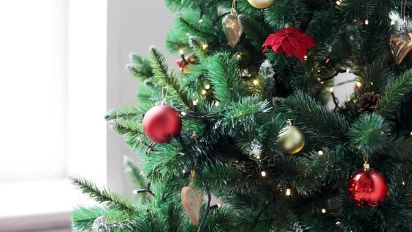 Thumbnail for Woman Decorating Christmas Tree With Ball 2