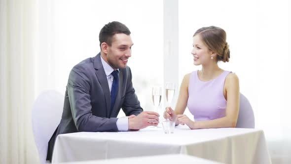 Thumbnail for Couple With Glasses Of Champagne At Restaurant