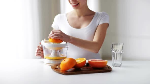 Thumbnail for Woman With Squeezer Squeezing Orange Juice At Home 1