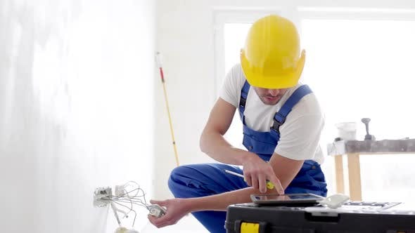 Thumbnail for Builder With Tablet Pc And Equipment Indoors 1