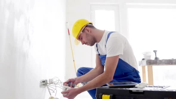 Builder With Tablet Pc And Equipment Indoors 2