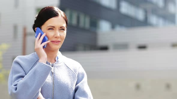Thumbnail for Young Smiling Businesswoman Calling On Smartphone 1