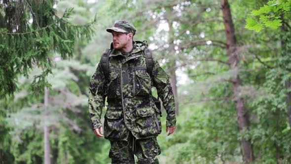 Thumbnail for Young Soldier With Backpack In Forest 1