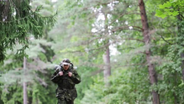 Thumbnail for Young Soldier With Backpack In Forest 2