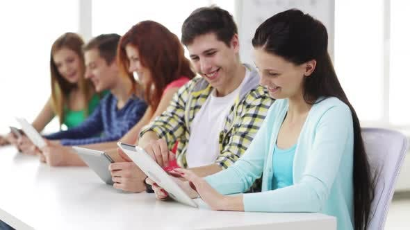 Thumbnail for Smiling Students With Tablet Pc At School 5
