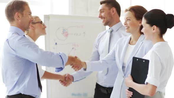 Thumbnail for Business People Shaking Their Hands 1