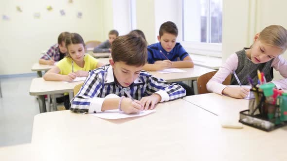 Thumbnail for Group Of School Kids Writing Test In Classroom 1