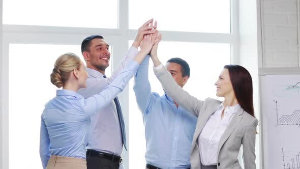 Thumbnail for Business Team Doing High Five Gesture In Office