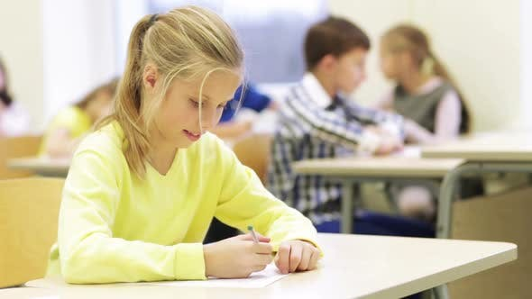 Thumbnail for Group Of School Kids Writing Test In Classroom 7