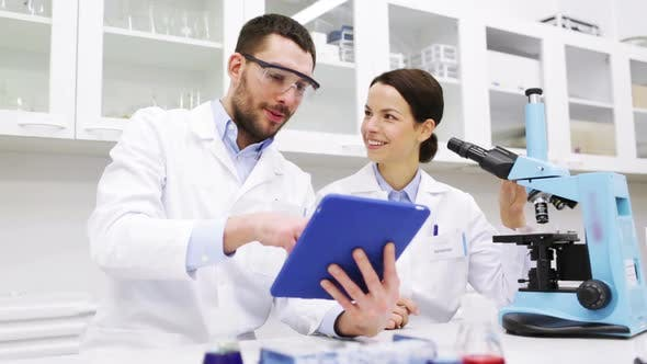 Thumbnail for Scientists With Tablet Pc And Microscope In Lab 1