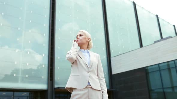 Thumbnail for Serious Businesswoman With Smartphone Outdoors 2