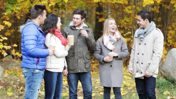 Thumbnail for Group Of Smiling Men And Women In Autumn Park 5