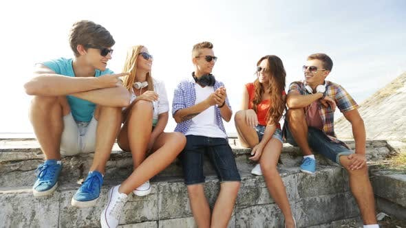 Thumbnail for Group Of Smiling Teenagers Hanging Out Outdoors 1