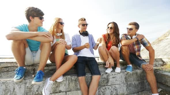 Thumbnail for Group Of Smiling Teenagers Hanging Out Outdoors 2