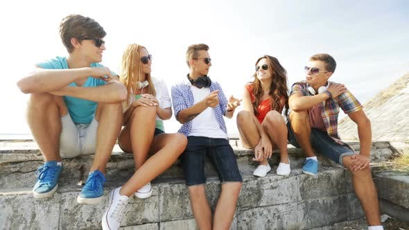 Thumbnail for Group Of Smiling Teenagers Hanging Out Outdoors 3
