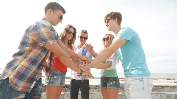 Thumbnail for Group Of Smiling Teenagers Hanging Out Outdoors 5