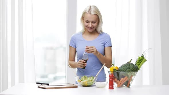 Thumbnail for Smiling Woman Cooking Vegetable Salad At Home 1