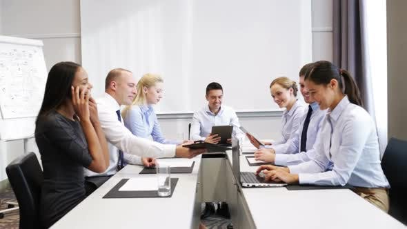 Thumbnail for Smiling Business People Meeting In Office 11
