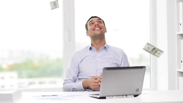 Thumbnail for Happy Businessman With Money And Laptop In Office 1