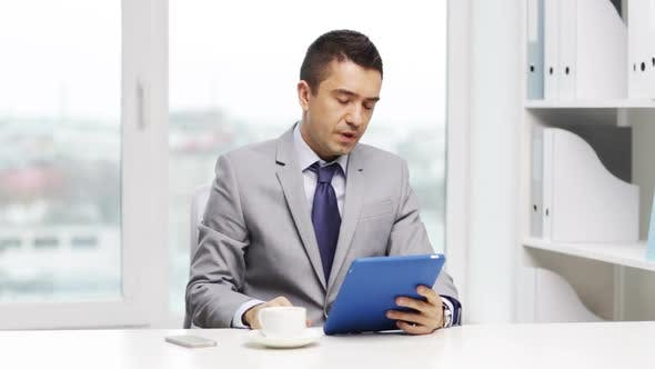 Thumbnail for Businessman With Tablet Pc And Coffee Cup