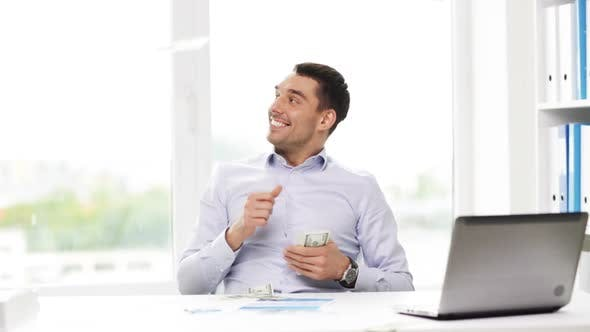 Thumbnail for Happy Businessman With Money And Laptop In Office 2