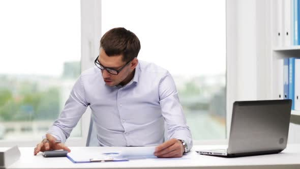 Thumbnail for Busy Businessman With Laptop And Papers In Office 10