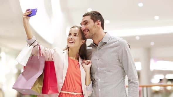 Thumbnail for Happy Couple With Smartphone Taking Selfie In Mall 1