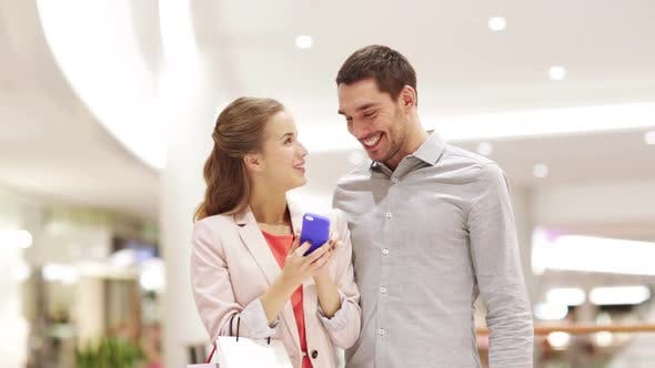 Thumbnail for Happy Couple With Smartphone Taking Selfie In Mall 2