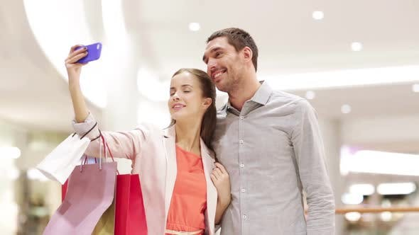 Thumbnail for Happy Couple With Smartphone Taking Selfie In Mall 3