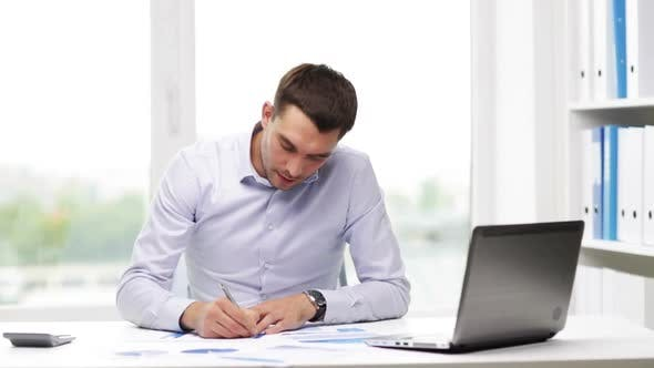 Thumbnail for Busy Businessman With Laptop And Papers In Office 19