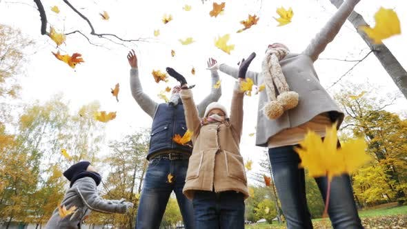 Thumbnail for Happy Family Playing With Autumn Leaves In Park 1