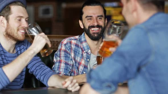 Thumbnail for Happy Male Friends Drinking Beer At Bar Or Pub 1