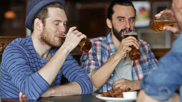 Thumbnail for Happy Male Friends Drinking Beer At Bar Or Pub 2